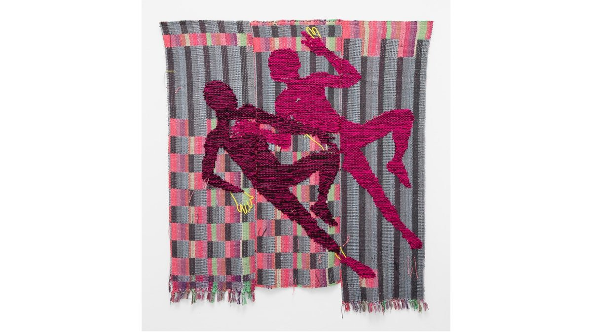 A weaving by Diedrick Brackens. The pink silhouettes of two male figures lie side-by-side, each with their left knee bent and right leg extended. Behind them is an abstract, colorful background of squares and stripes.